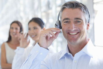Close up portrait of smiling businessman wearing headset