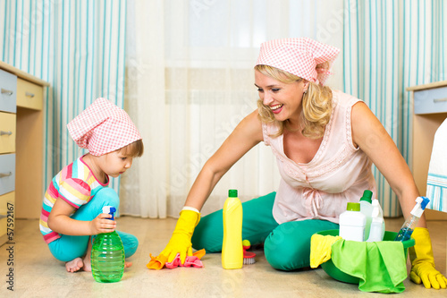 mother and kid cleaning room
