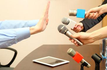 Conceptual photo of businessman or politician giving no