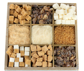 Different types of sugar in wooden box isolated on white