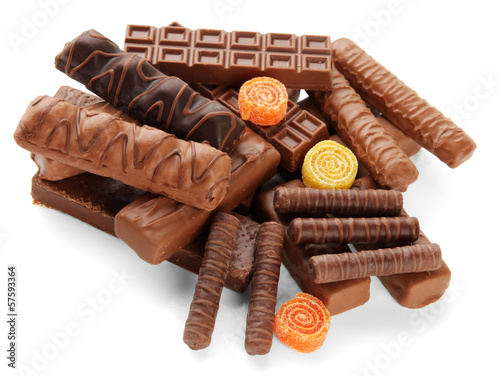 Delicious chocolate bars with marmalade sweets close up