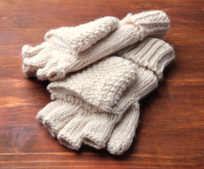 Wool fingerless gloves, on wooden background