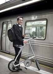 Businessman Commuting by Bicycle and Subway