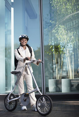 Businesswoman with Folding Bike