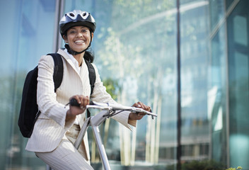 Businesswoman on Folding Bike
