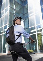 Businessman with Solar Panelled Backpack on Folding Bike