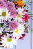 Fototapety Wildflowers on wooden table