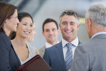 Portrait of smiling businessman among co-workers