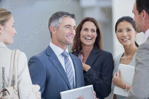 Happy business people talking