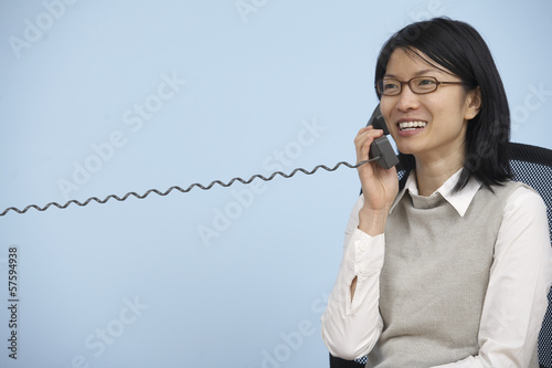 Businesswoman Using Landline Telephone