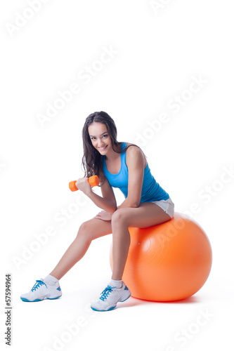 Cute skinny girl doing aerobics, isolated on white