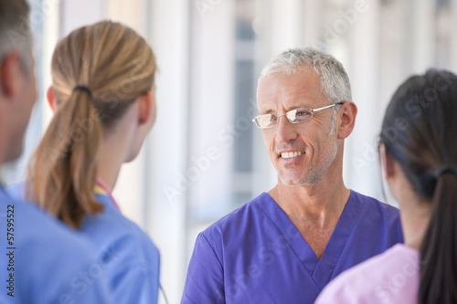 Close up of doctors and nurse talking