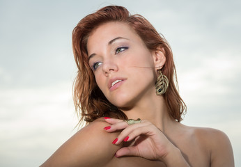 Young red head woman looking away