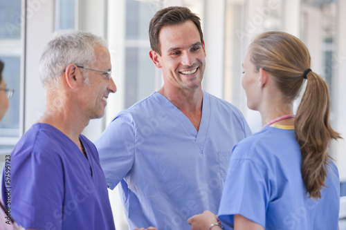 Smiling doctors talking