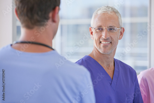 Close up of smiling doctors talking