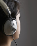 Close-Up of Woman Listening to Headphones