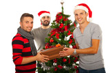 Happy friends celebrate Christmas