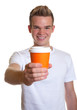 Young man showing a cup of coffee