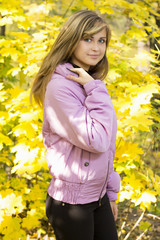 portrait of a beautiful girl on a background of autumn park