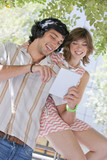 Smiling young couple using digital tablet