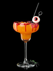 Bloodyhalloween cocktail with eye in a margarita glass