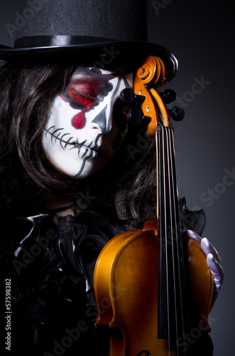 Monster playing violin in dark room