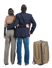 Young couple traveling with suitcas
