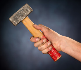 workmans hand with hammer
