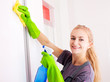 Woman cleaning cupboard