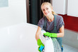 Woman cleaning bath