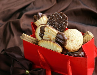 variety of cookies with chocolate and almonds in a gift package