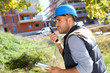 Foreman on site using walkie talkie