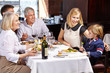 Family with child and grandparents in restaurant