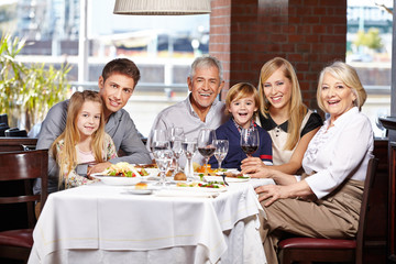 Family with children and seniors in restaurant