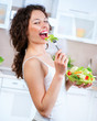 Beautiful Young Woman Eating Vegetable Salad. Dieting concept