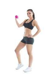 Fit slender woman training her arm