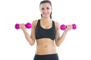 Peaceful active woman training her arms with pink dumbbells