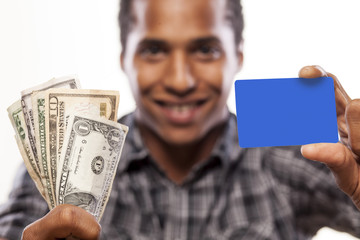 smiling Affrican man showing credit card and money