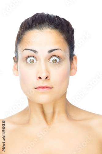 Front view of shocked brunette woman looking at camera