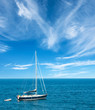 Luxury yatch in open waters with beautiful clouds