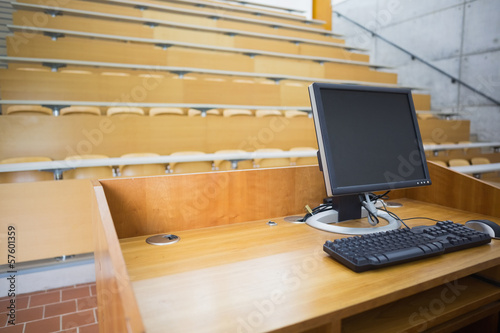 Computer monitor with empty seats in a lecture hall
