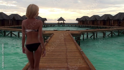 Girl at the water bungalows pontoon. Maldives