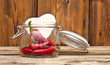 red chilly peppers in glass jar with cardboard heart on wood bac
