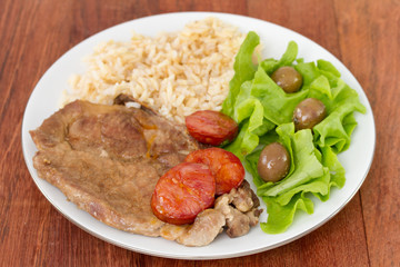 fried meat with rice and salad