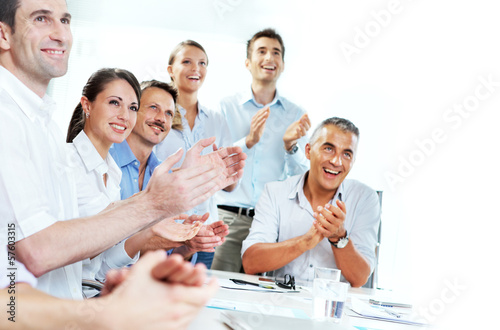 Business people clapping in a meeting