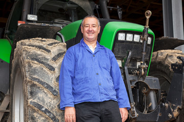 Farmer standing in front of his tractor