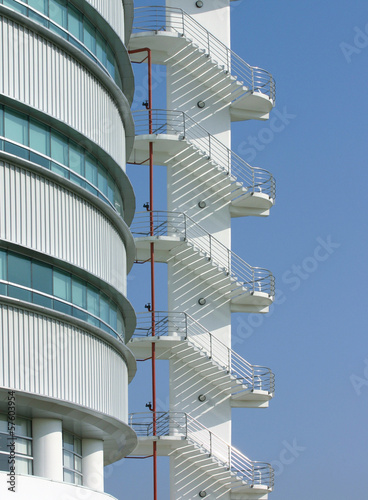Fire escape staircase outside the building with blue sky