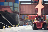 Container ship being unloaded at commercial dock