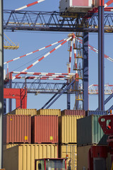 Crane and cargo containers at commercial dock
