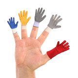 Five different small gloves wearing a hand